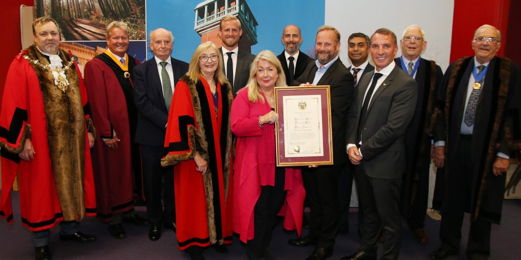 From left, the Mayor of Charnwood Cllr Paul Baines; Lez Cope-Newman, Freeman of the borough; Deputy Council Leader Tom Barkley; Deputy Mayor of Charnwood Cllr Jenny Tillotson; Kasper Schmeichel; Leicester City FC Chief Executive Officer Susan Wheelan; Council Chief Executive Rob Mitchell; Tony Kavanagh, head of operations at the training ground; Cllr Jewel Miah; Brendan Rodgers; Alderman Robert Shields and Alderman Paul Day