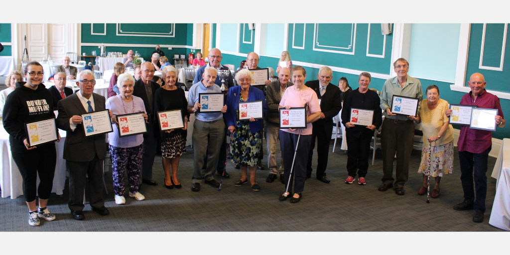 Photo of winners and runners-up at 2021 tenant garden competition at Loughborough Town Hall.