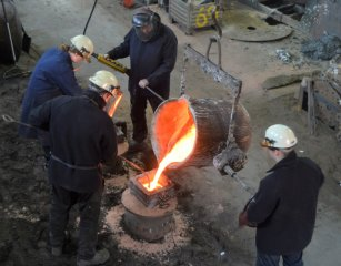 The molten metal is poured into a cast