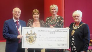 Former mayor hands a cheque to charity MyAware