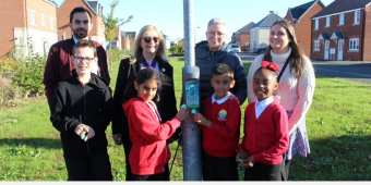 Deputy Mayor of Charnwood, Cllr Jenni Tillotson, the Council's lead member for Community support and Equalities, Cllr Leigh Harper-Davies with pupils and staff members at Hallam Fields Primary School at the launch of Beat the Street, South Charnwood.