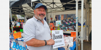Photo shows Roger from Boon's Hosiery at his market stall